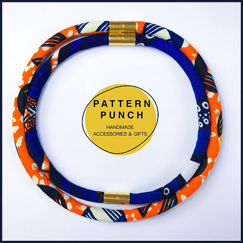 Fabric rope necklace with orange and royal blue with magnetic clasps