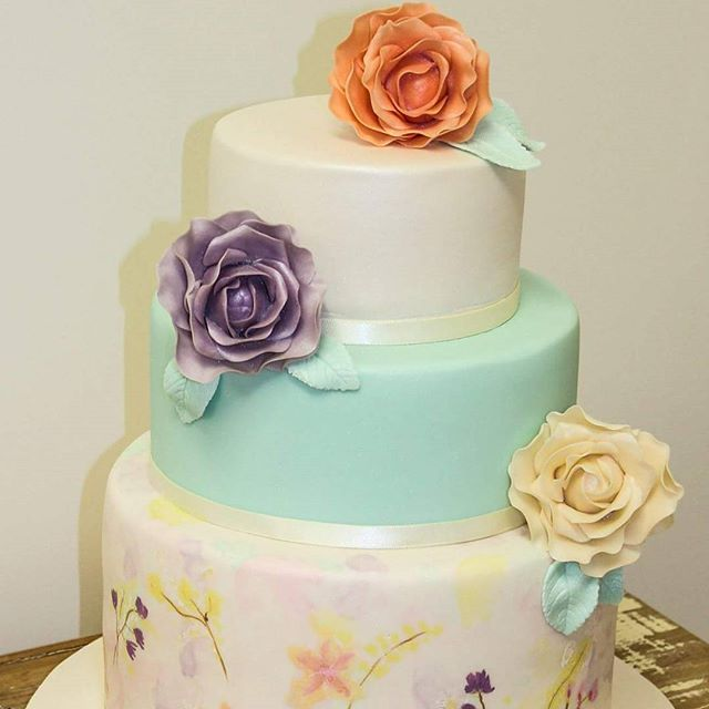A sea of pastels_#weddingcake #watercolourpaintcake #pastels #colourful #sugarflowers #pretty