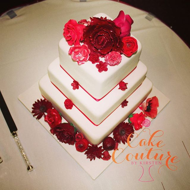 Blooming reds_#weddingcake #sugarflowers #redflowers #squareweddingcakes #gerbras #peonies #poppys #