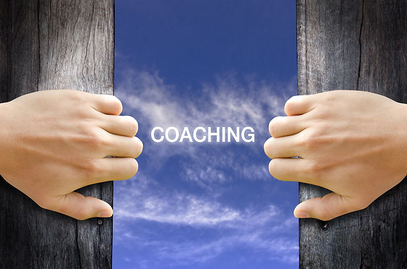 _coaching_ text in the sky behind 2 hand