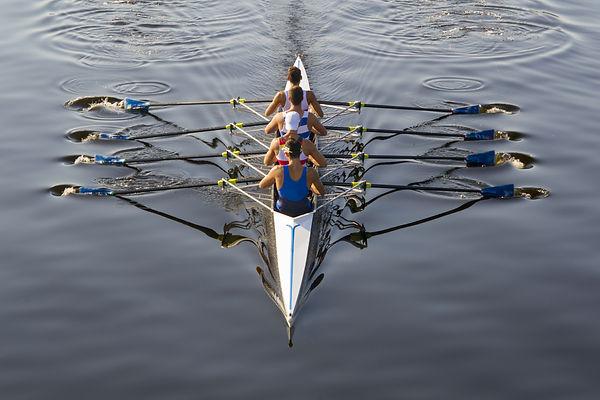 rowers paddling in a beautiful italian l