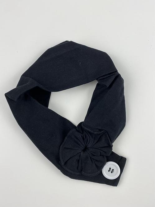 Bandeau noir sobre bouton blanc