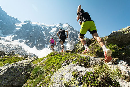 Wellness travel planners on a run in the mountains