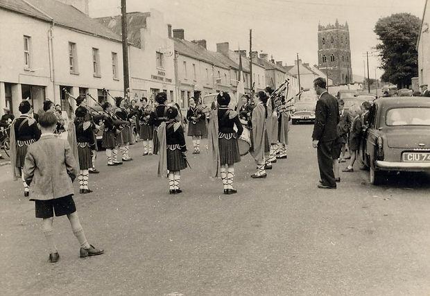 Children's pipe band on main street of Ballylanders.