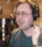 Russ singing into a studio microphone