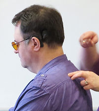 Russ's back with hands performing Social-Haptic Communication