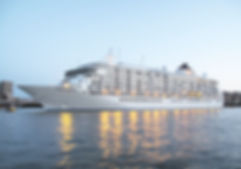 Daytime image of a cruise ship in a harbour