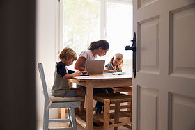 Mum-and-two-kids-working-in-kitchen,-clo