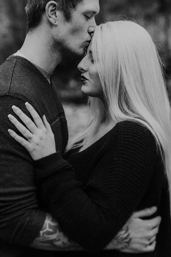 Sweet kisses on the forehead in the mountains! Black and White photo!  Engagement Session | Katy Shay Photo | Montana Photographer