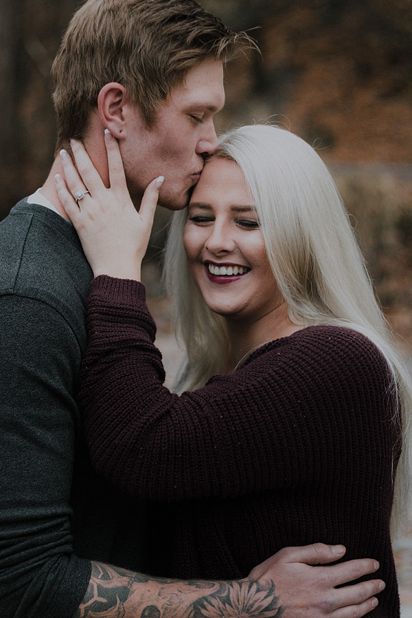 Sweet kisses on the forehead in the mountains at the end of fall! Black and White photo!  Engagement Session | Katy Shay Photo | Montana Photographer
