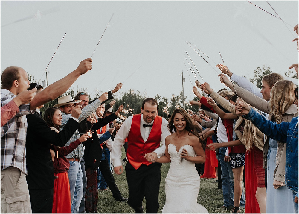 sparkler send off with bride and groom running through  middle of the day wedding Crazy Mountains | Dejong Wedding in front of the mountains Big Timber, MT | Katy Shay Photo; Missoula, Montana photographer