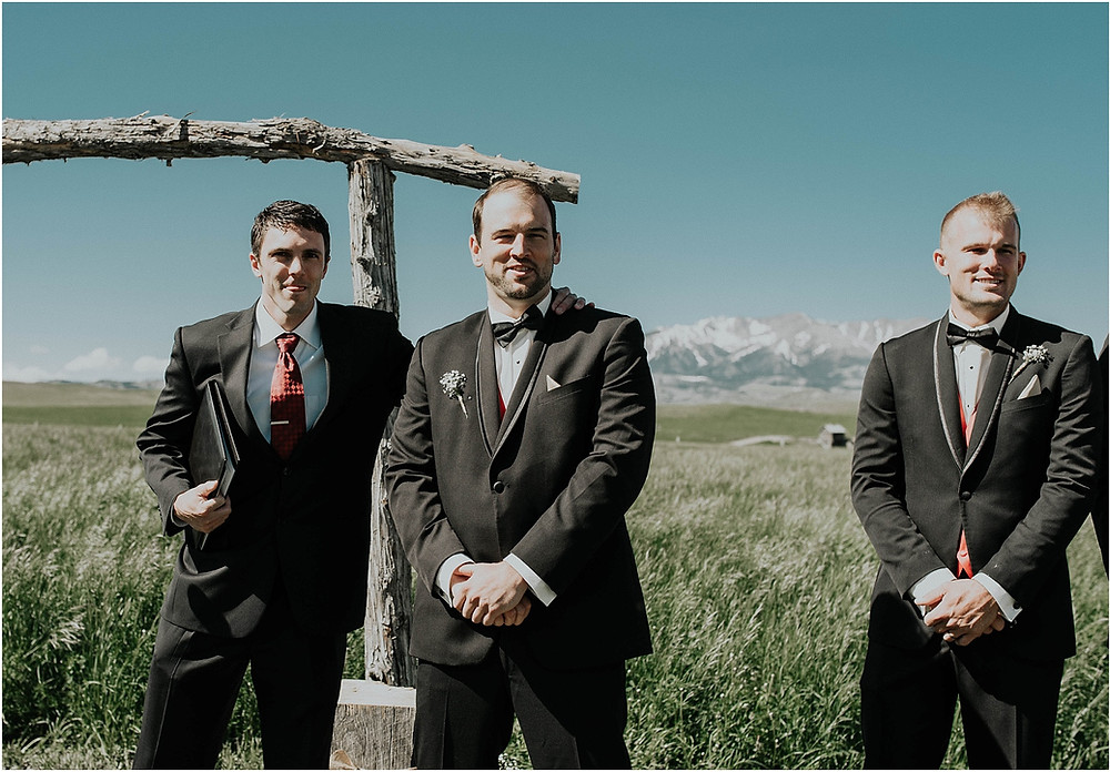 mountain wedding, groom sees bride walking down the isle grooms reaction to seeing bride, first look Crazy Mountains | Dejong Wedding in front of the mountains Big Timber, MT | Katy Shay Photo; Missoula, Montana photographer