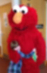 Little girl hugging Elmo.jpg