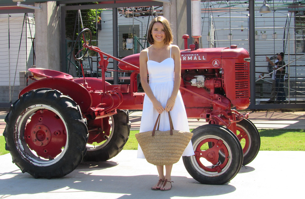 Annie in font of tractor