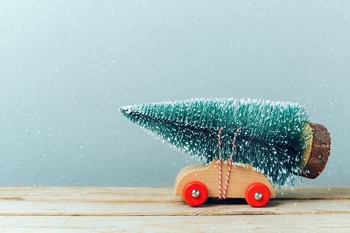 Christmas tree on toy car. Christmas holiday celebration concept.jpg