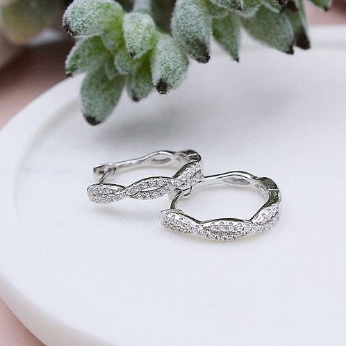 Sterling Silver Cubic zirconia entwined wave huggie earrings