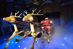 Father Christmas setting off on his sleigh to deliver presents to kids
