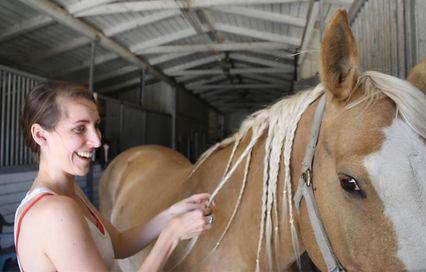 happy equus life coach client with horse