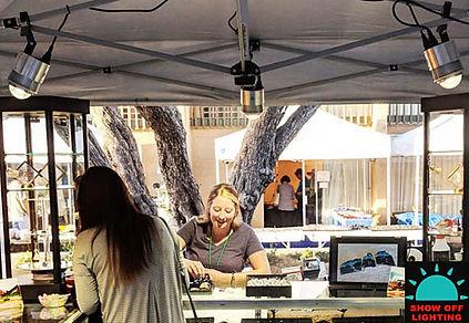 Amazing pipe & drape trade show tent lighting