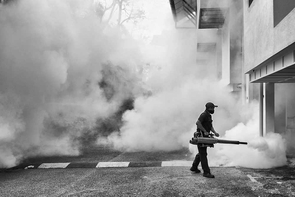 A worker fogs around a condo to control adult mosquitoes, in Kuala Lumpur, Malaysia. On September 1st 2016 Malaysia confirmed the first case of the Zika virus infection in the country involving a woman who had returned from a visit to Singapore.