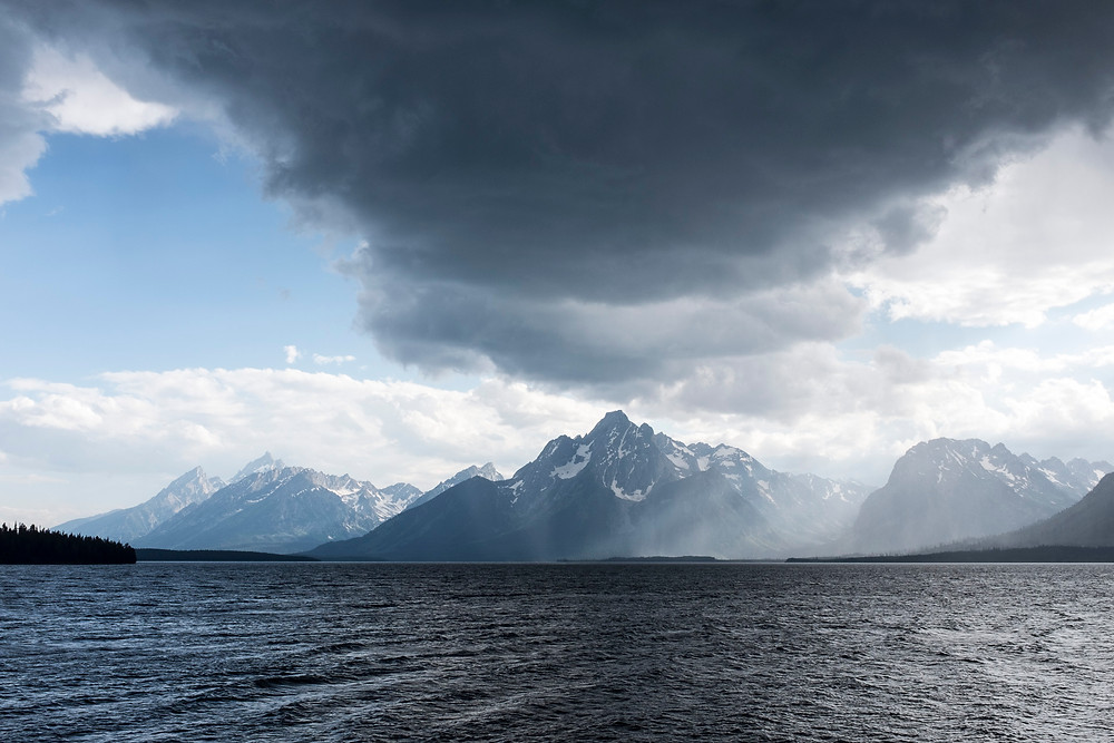 color photograph of Storm cloud over grand teton mountains