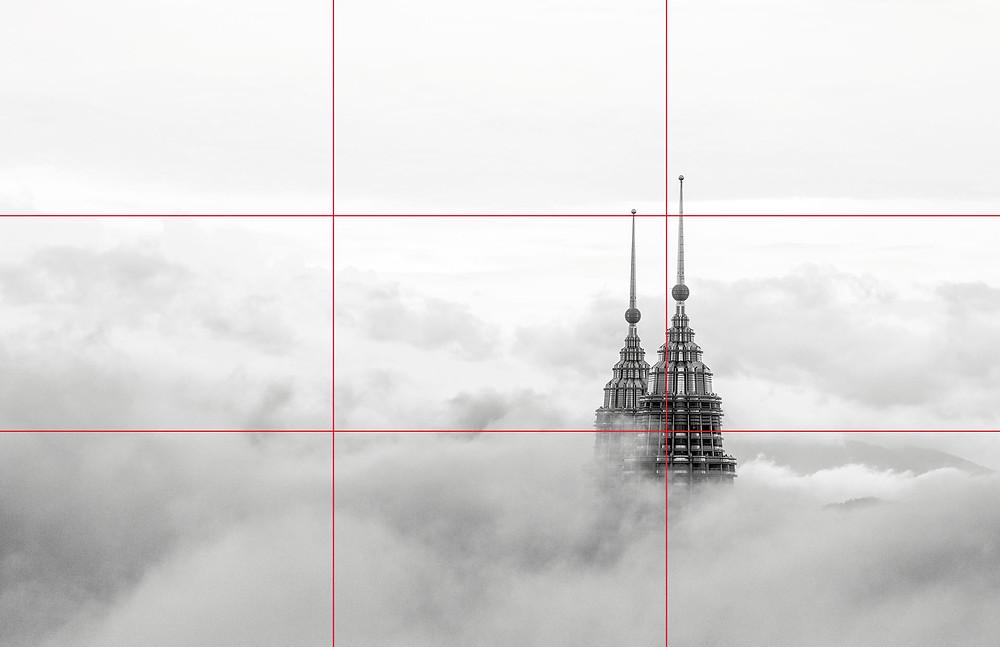 The top of the Petronas Towers peeking above the clouds in Kuala Lumpur, Malaysia.