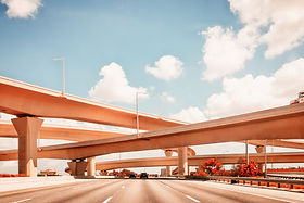 photographic composition of highway and overpasses
