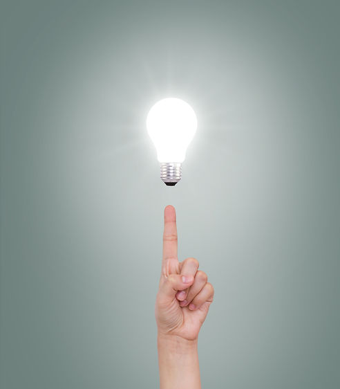 index-finger-pointing-at-an-illuminated-bulb.jpg