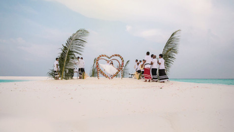 The white sandy beach is all decorated to welcome the new bride and groom