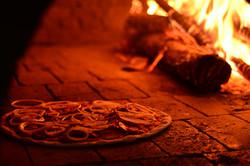 pizza no forno a lenha