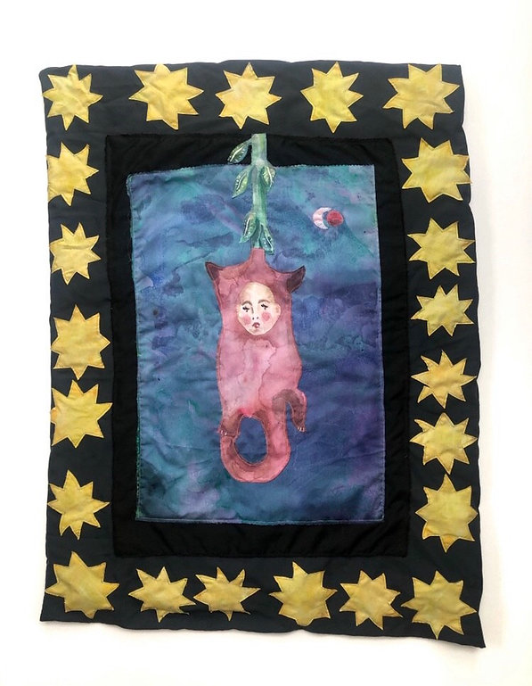 An quilt of what seems to be a hanging fruit that is some sort of small pink animal with a tail and the face of a human baby. The frame is made of quilted stars.