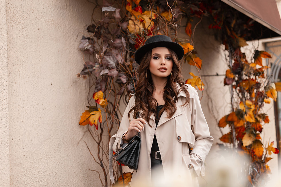 Beautiful fashionable woman with stylish clothes look in a gray classic coat and a vintage