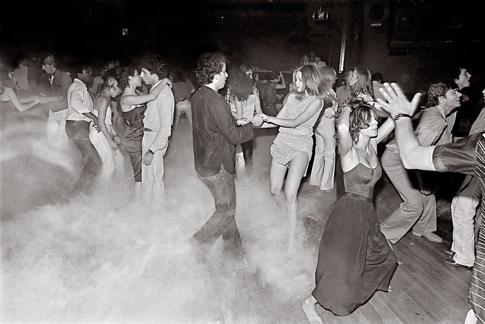 Black and White image of people on the dance floor at Xenon, New York.