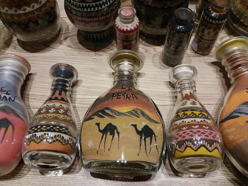 Bottle's filled with colourful sand