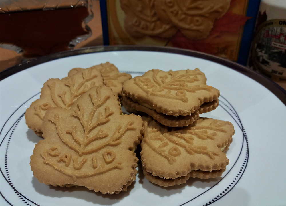 A white plate with David maple leaf shaped maple sandwich biscuits.