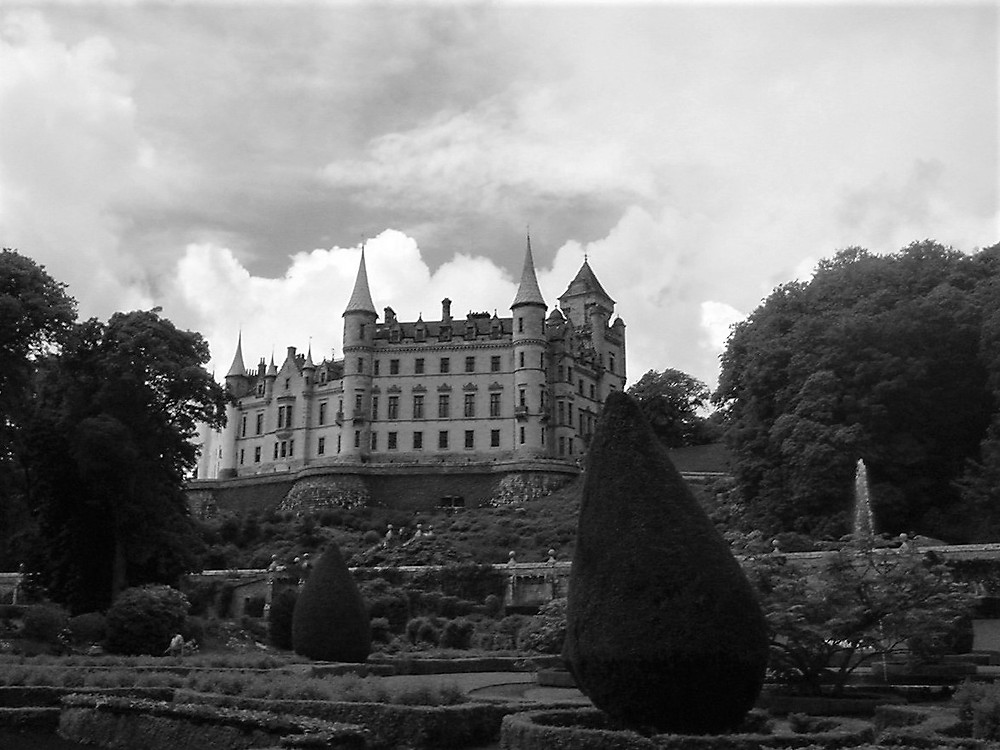 Black and white photograph taken at the back of Dunrobin Castle with the formal landscaped gardens.