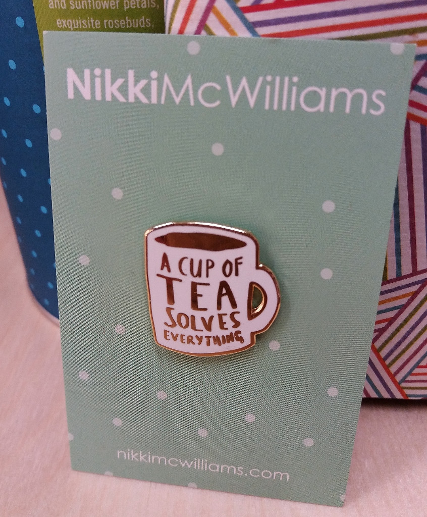 """An enamel pin badge gift for all those tea lovers - saying """"A cup of tea solves everything""""."""
