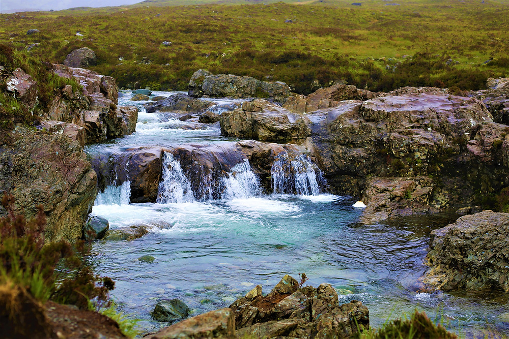 The magical blue water pools and falls, carving there way through the landscape.