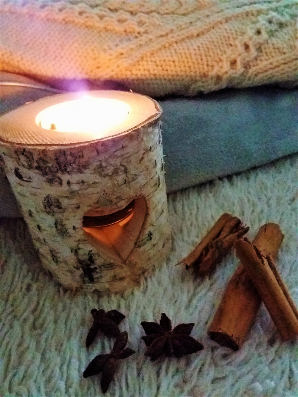 Birch log heart candle holder with winter textiles and warming spices