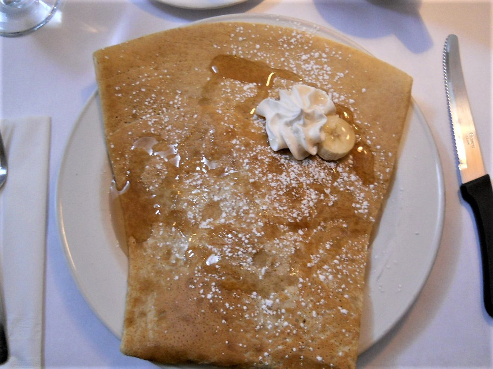 Banana and Maple Syrup Crepe on a white plate