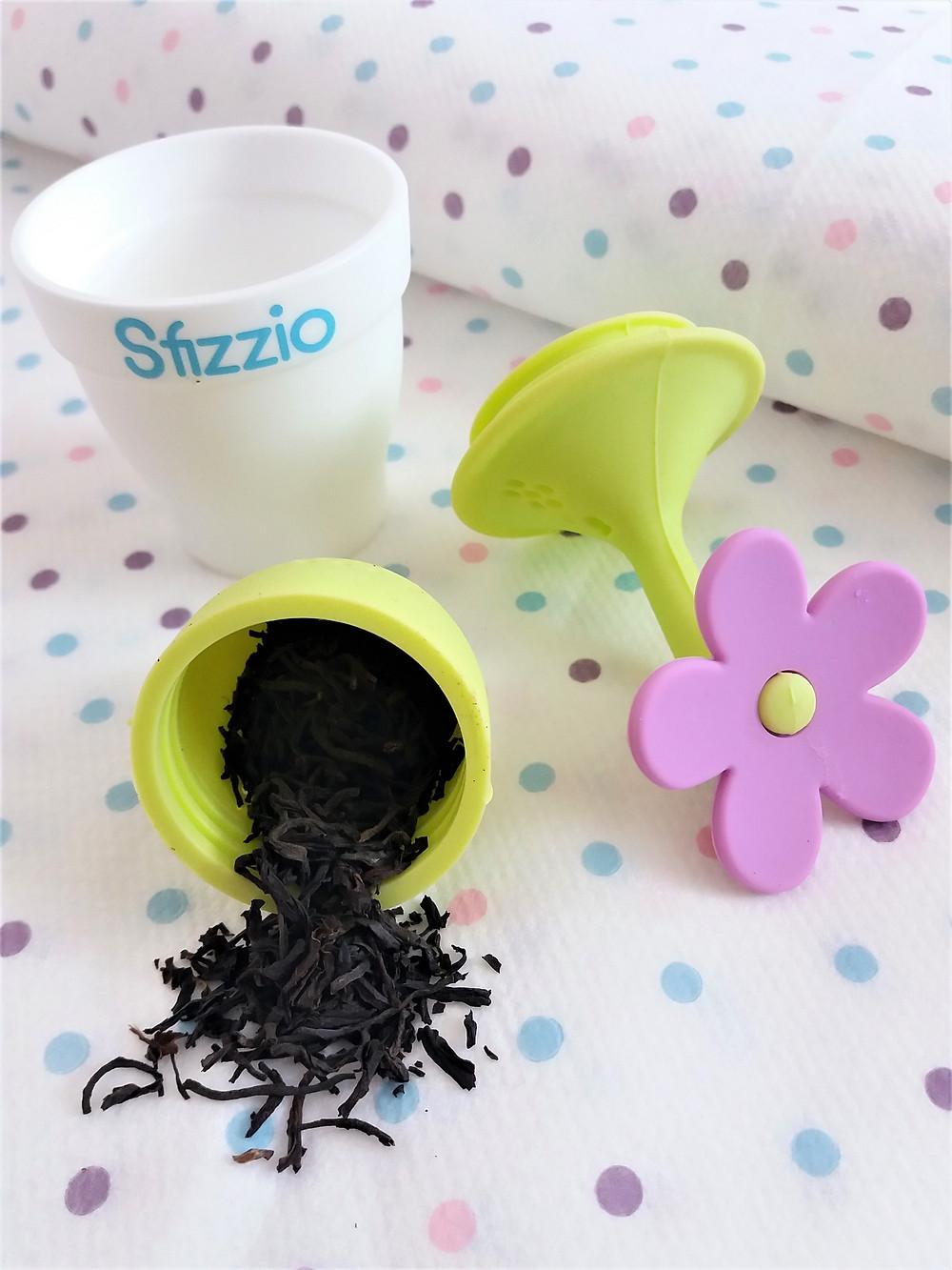 Close up image of Sfizzio Tea Infuser parts and loose tea.