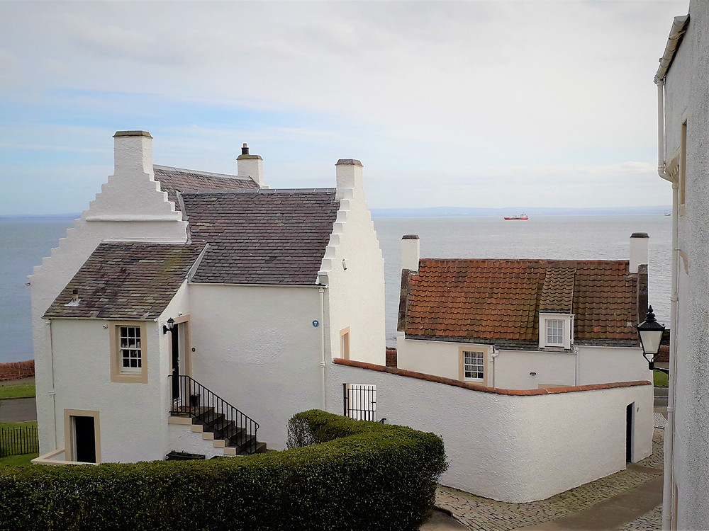 Traditional historic white painted houses in coastal Fife.