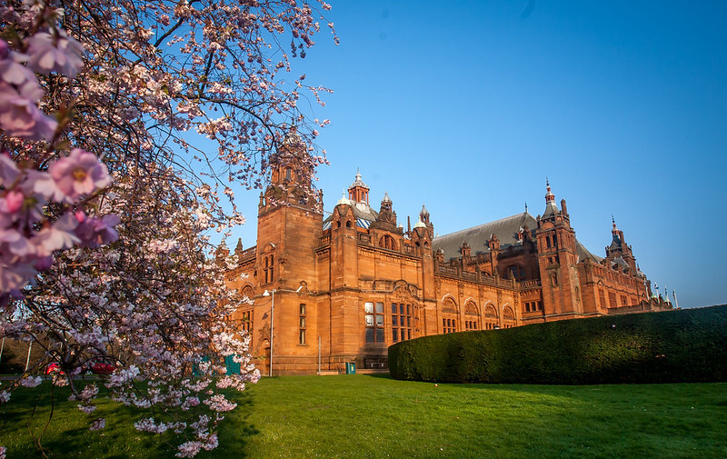 Landscape photograph of cherry blossoms at the side of Kelvingrove Art Gallery and Museum.