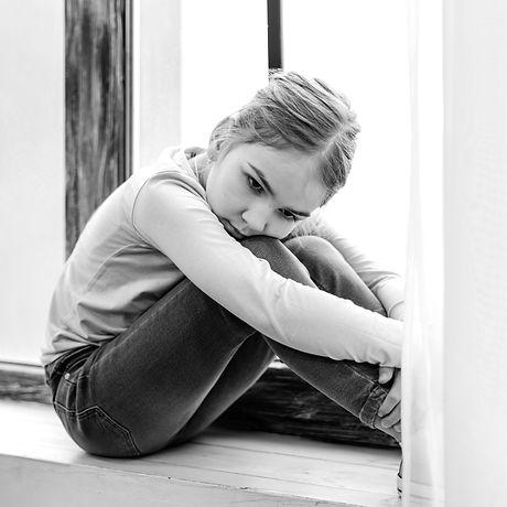 bored-little-girl-sitting-window-sill_ed