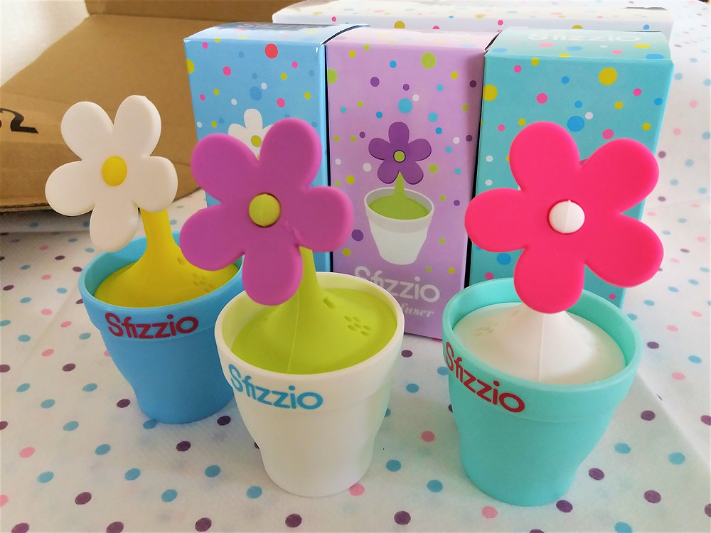 Three colourful Sfizzio tea infusers with their own colourful boxes.