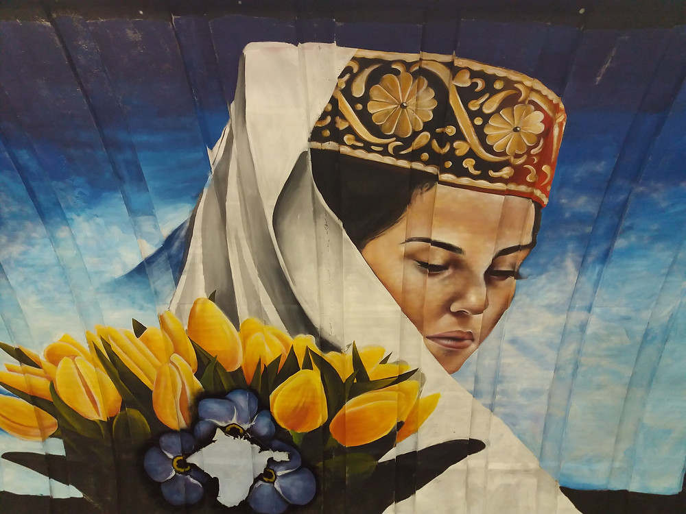 Lady Dressed in Traditional Clothes With Bunch of Yellow Tulips, KyivSubway, Ukraine ©MDHarding