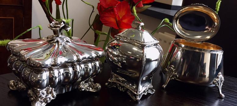 Three different styles of silver tea caddies