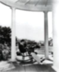 oscar typing on porch.jpg