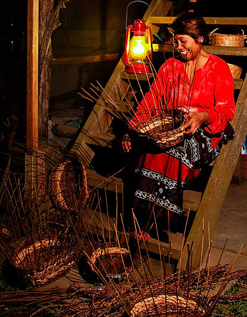Lady weaving baskets for Basket Trend Home Products Inc