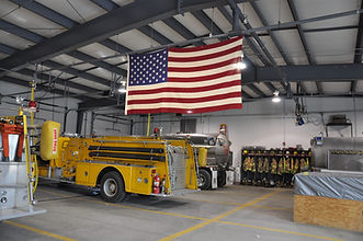Picture of firehouse with flag flyin